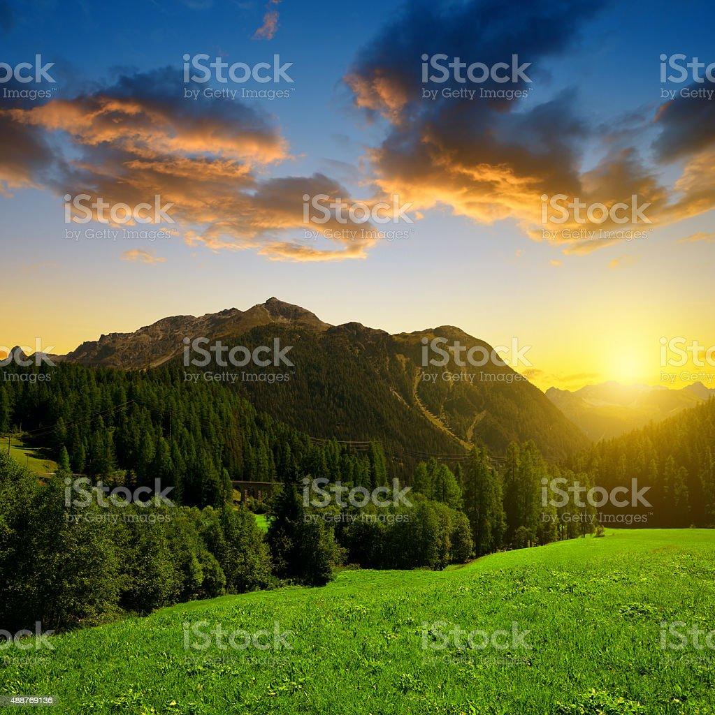 Beautiful Alpine landscape with mountain range at sunset stock photo