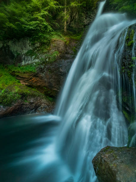 beautiful alpine waterfall at sunset - bioremediation stock photos and pictures