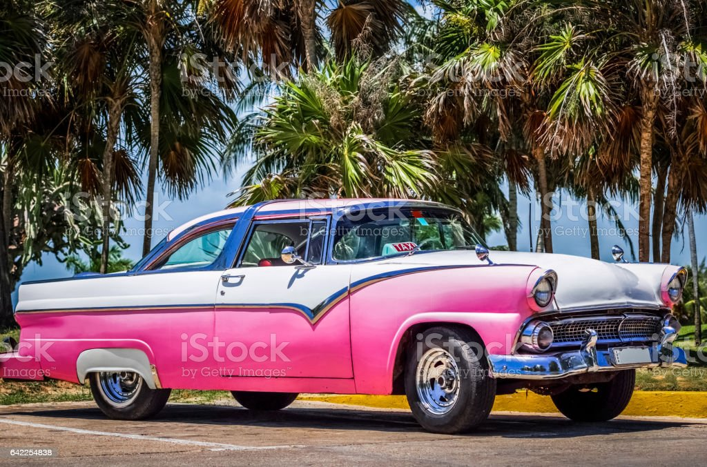 HDR  Beautiful American pink white vintage car in Varadero Cuba stock photo