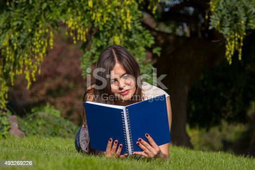 istock Beautiful American student in campus 493269226