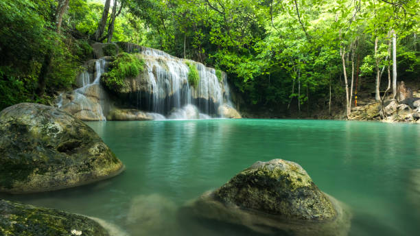 beautiful and breathtaking green waterfall at the tropical rain forest, erawan's waterfall, located kanchanaburi province, thailand - dazzlingly stock pictures, royalty-free photos & images