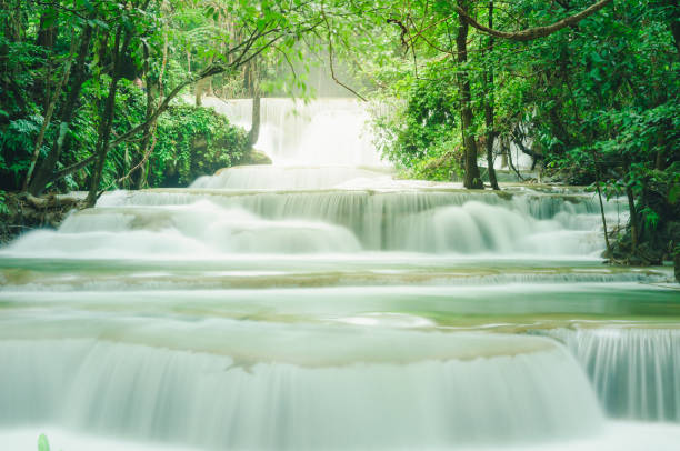beautiful and breathtaking green waterfall at the tropical rainforest, erawan's waterfall, located kanchanaburi province, thailand - dazzlingly stock pictures, royalty-free photos & images