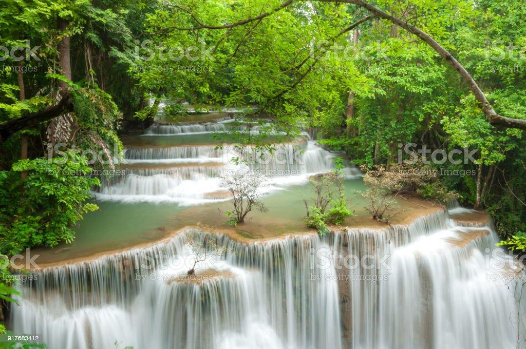 Beautiful and Breathtaking green waterfall, Huay Mea Kamin's waterfall, Located Kanchanaburi Province, Thailand stock photo