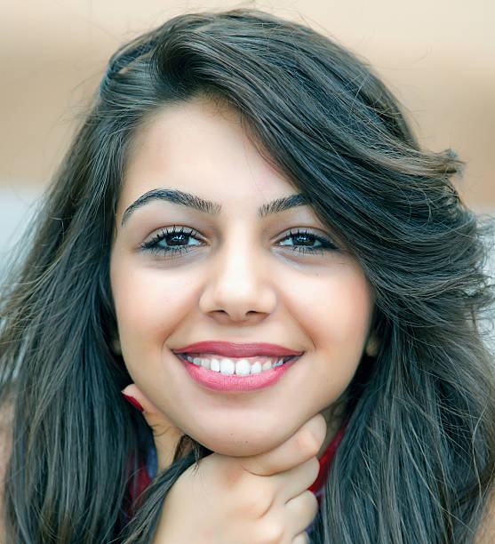 Beautiful and cheerful young arabic brunette stock photo