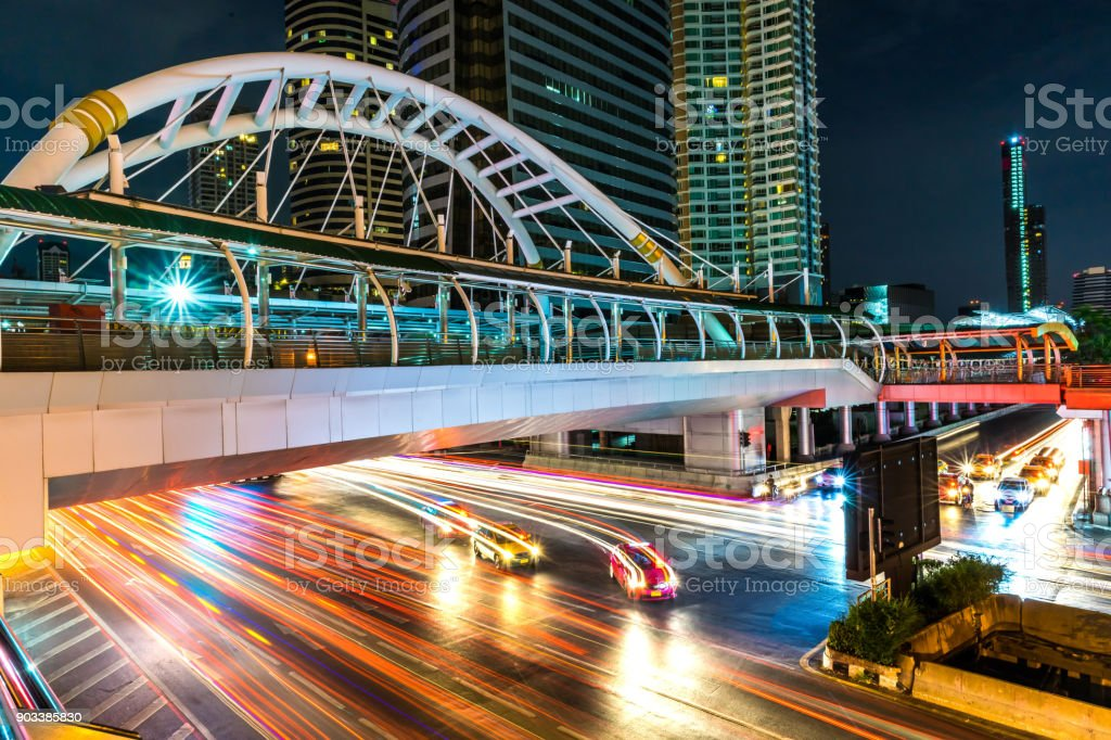 Beautiful and colorful light trails of the vehicles under the skywalk...