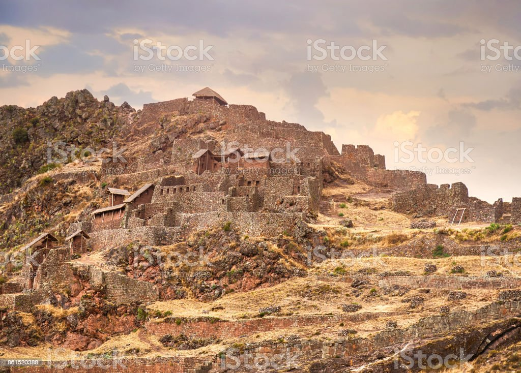 Beautiful and complex Incan stone construction terraced on steep hill in Pisac, the Sacred Valley of the Incas. stock photo