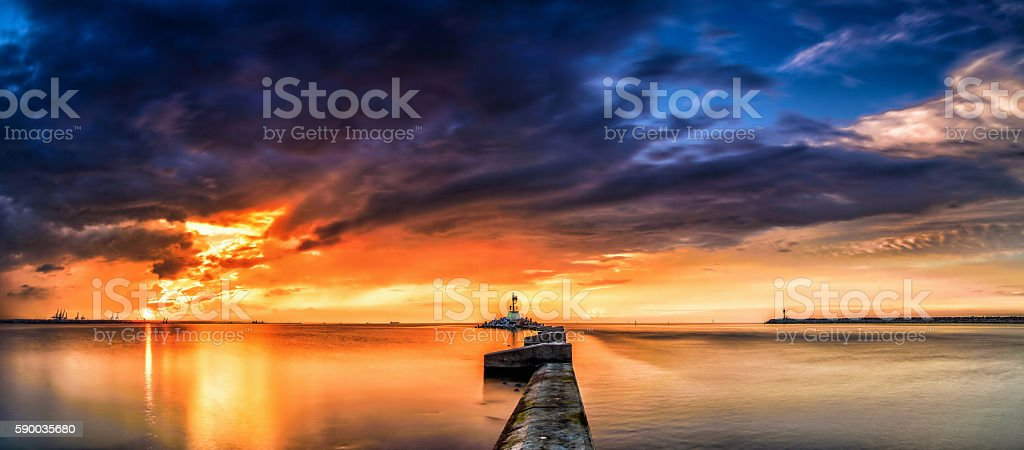 Beautiful and dangerous sunset over the bay of Gdansk panorama stock photo