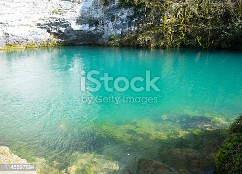 Beautiful and deep mountain lake with emerald water color