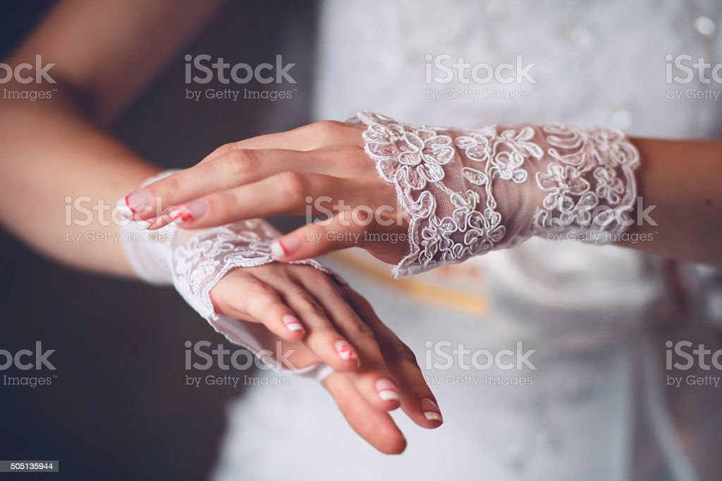 Beautiful and elegant hands of bride stock photo