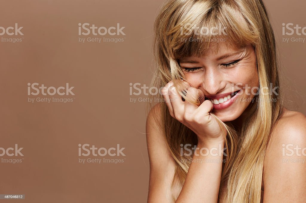 Beautiful and excited blond woman stock photo