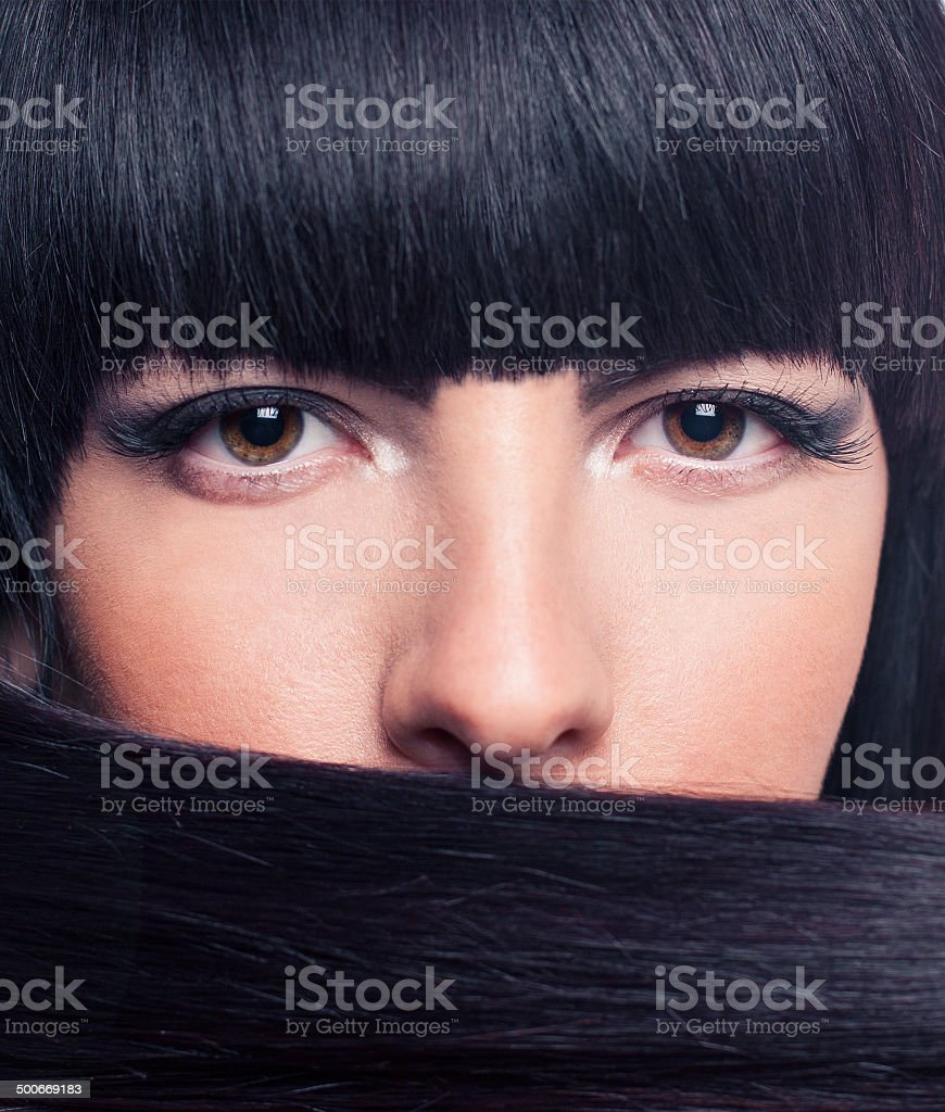 Beautiful and happy young girl holding hair in the face royalty-free stock photo