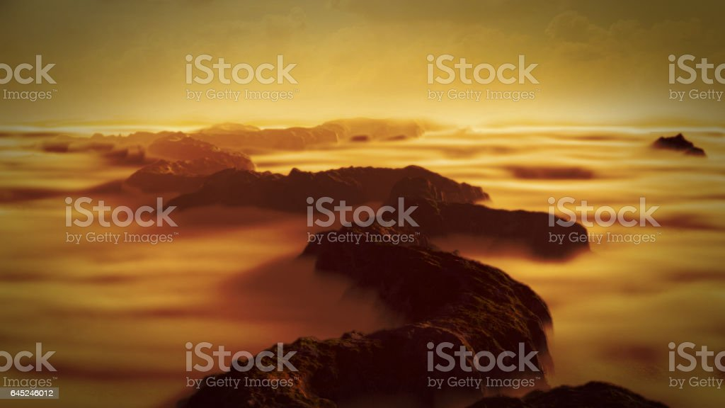 beautiful and mysterious mountain range landscape with low crawling clouds stock photo