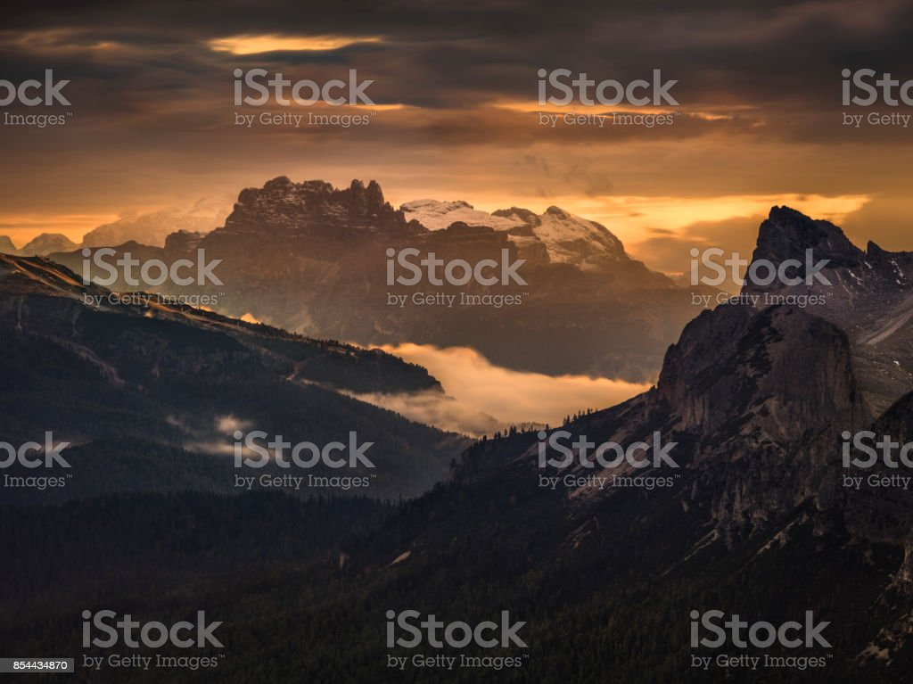 A beautiful and mysterious sunset in the Dolomites stock photo