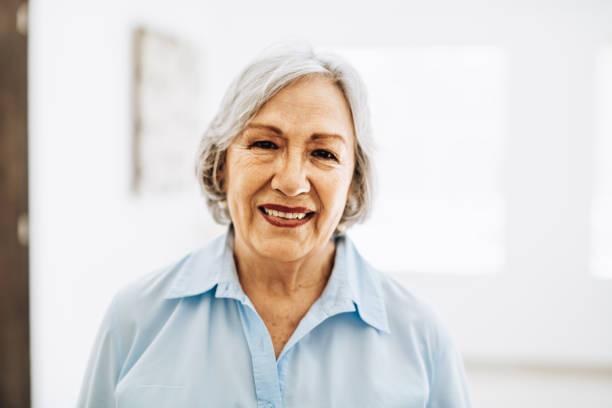 Beautiful and sensual 75 year old Latina senior woman stock photo
