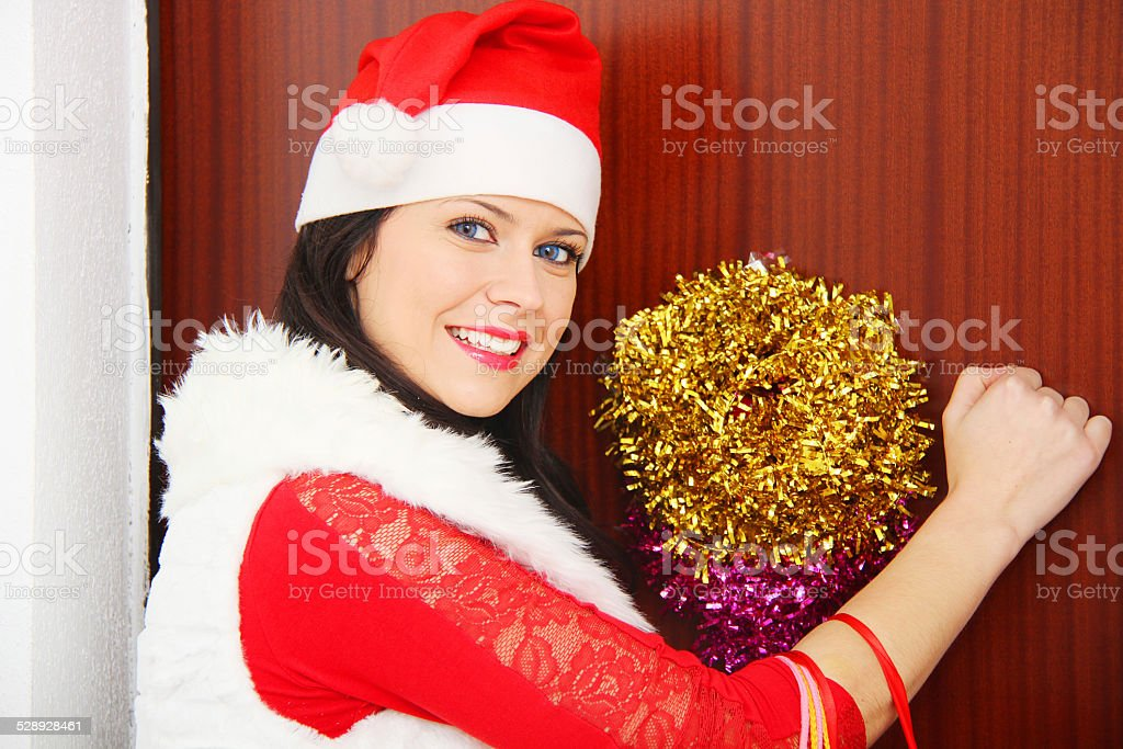 Beautiful and sexy woman wearing santa clause costume and waitin stock photo