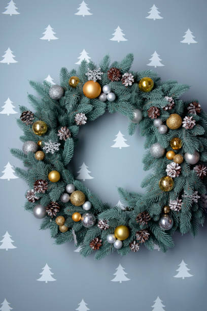 Beautiful and stylish wreath made of decorative toys balls and pine cones stock photo