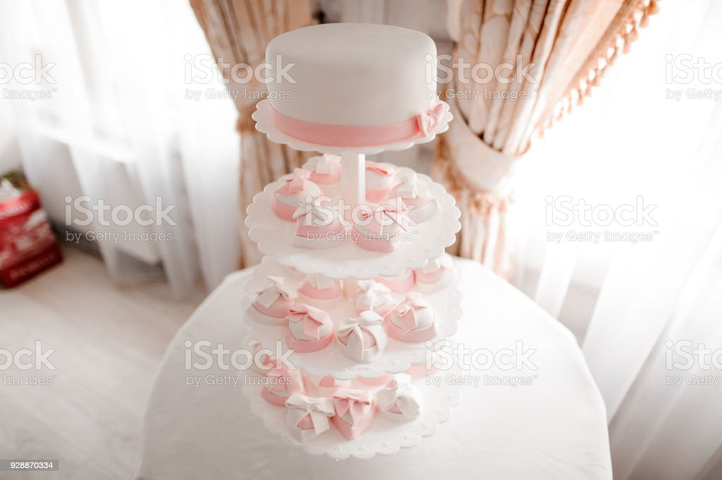 Beautiful and tasty pink and white wedding cake stock photo
