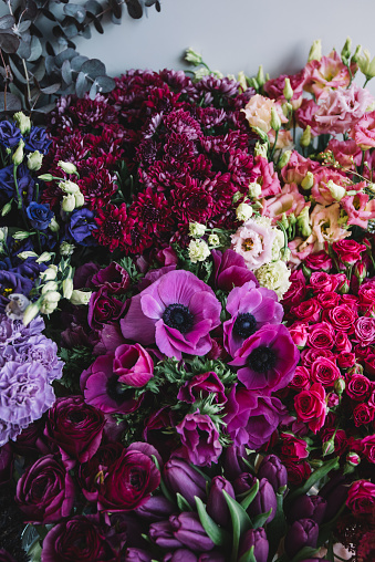 istock Beautiful and tender blossoming and endless fresh flowers at the florist shop in lavender, pink and purple colors 928570014