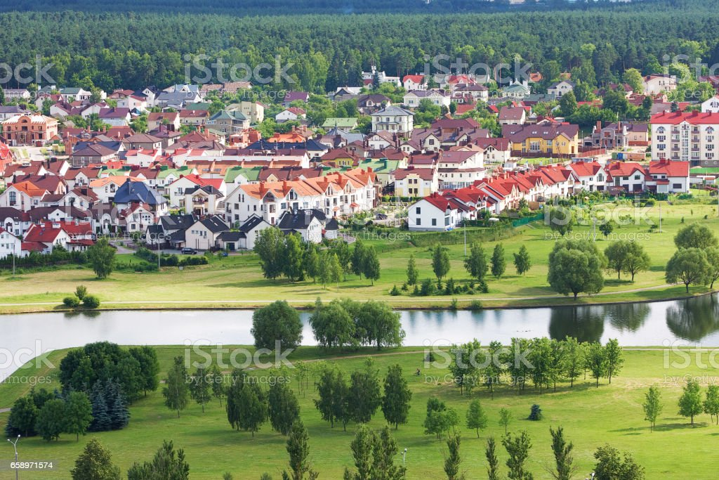 Beautiful and tidy living quarters in Minsk, Belarus cituated near green park and river. White houses with red roofs stock photo