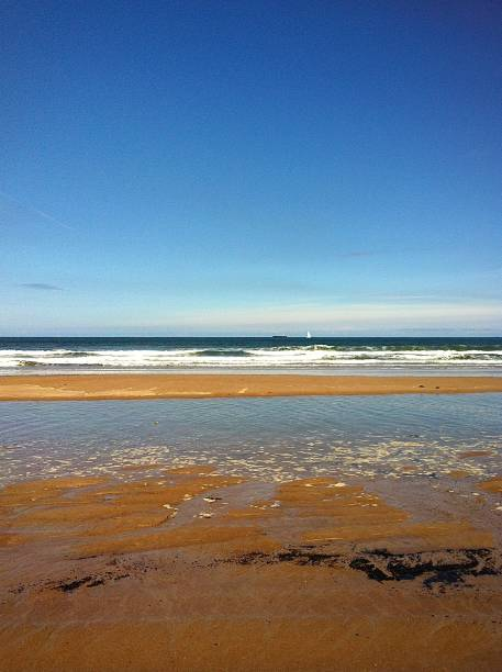 A beautiful and tranquil North East British beach. stock photo
