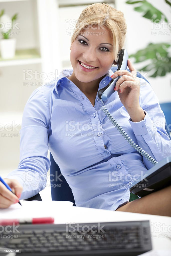 Beautiful and very sexy secretary working in office - Stock image .