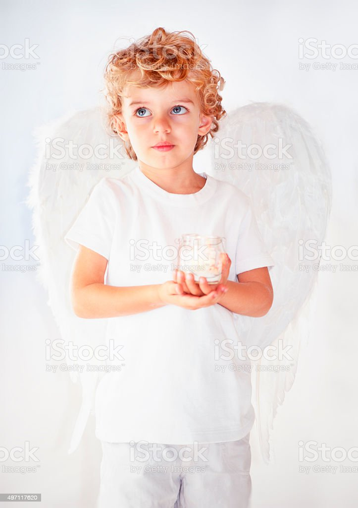 Beautiful angel with a candle stock photo