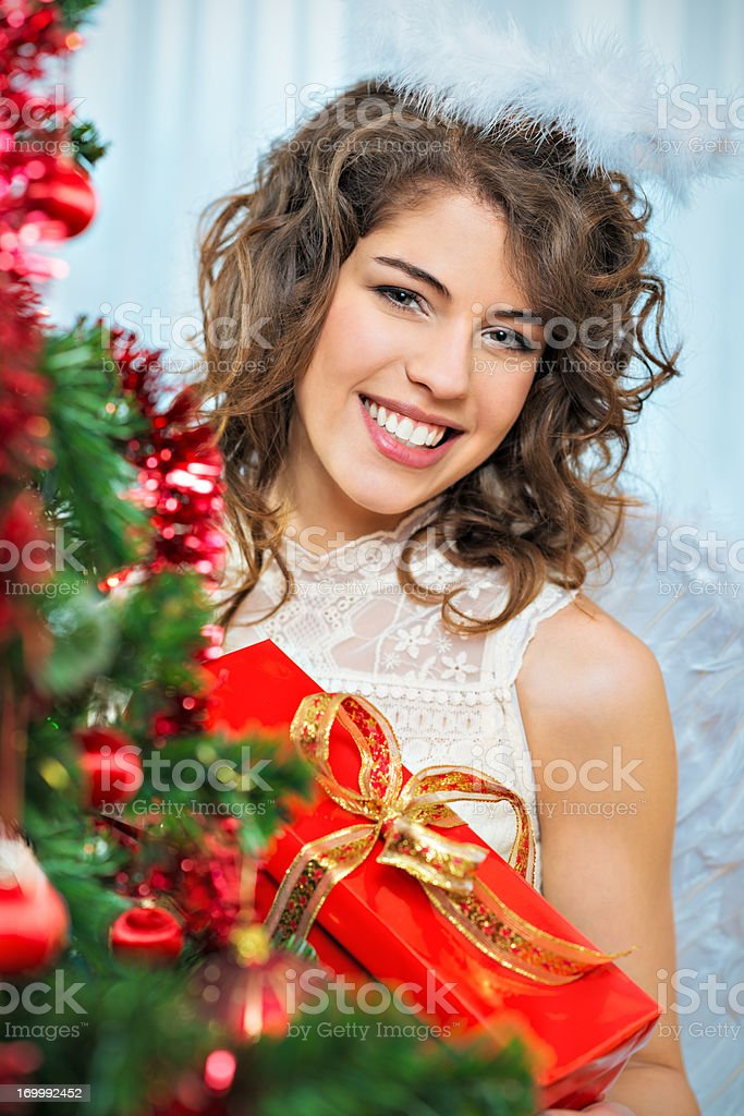Beautiful angel with xmas gift royalty-free stock photo