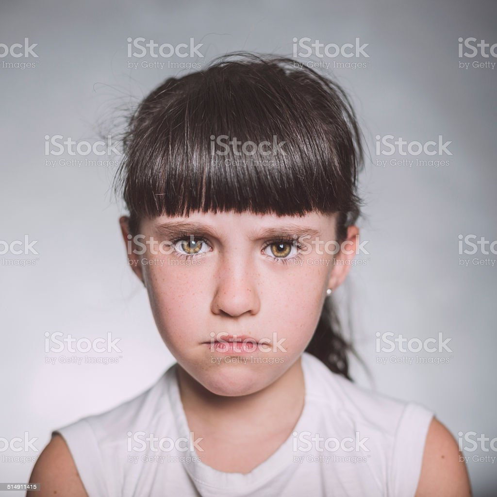 Beautiful angry girl. stock photo