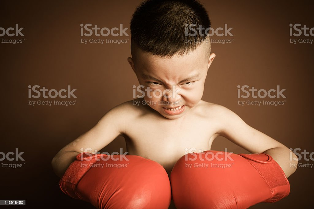 beautiful angry young boy play boxing with gloves stock photo