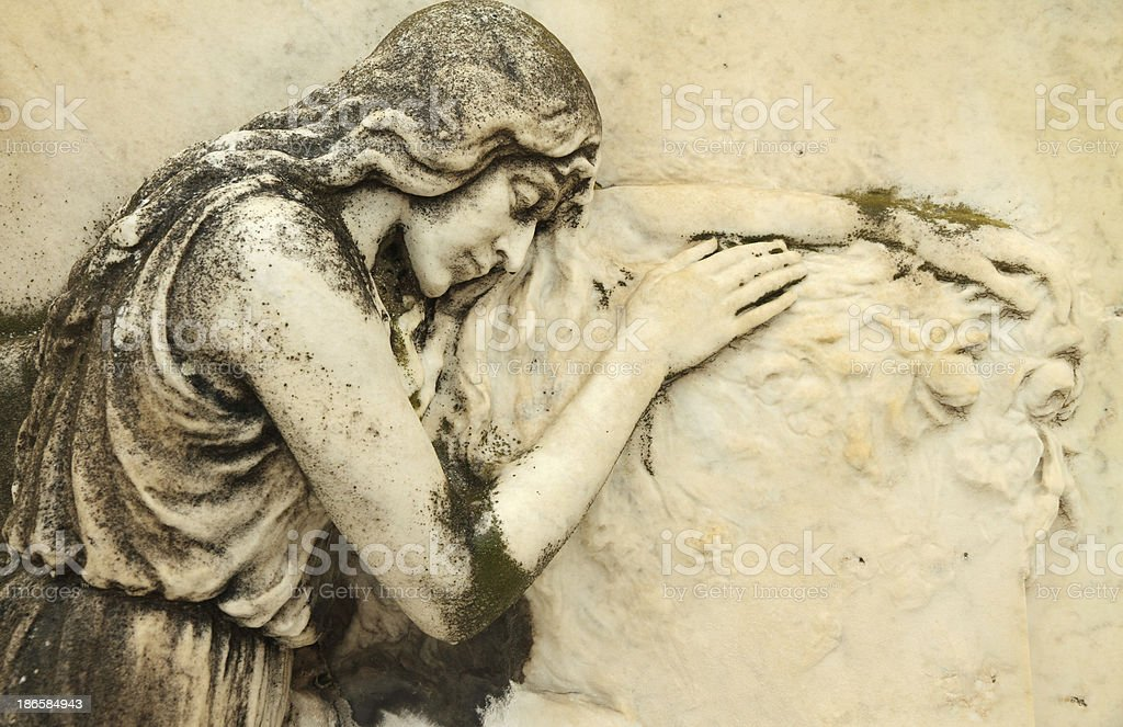 beautiful antique cemetery bas-relief stock photo