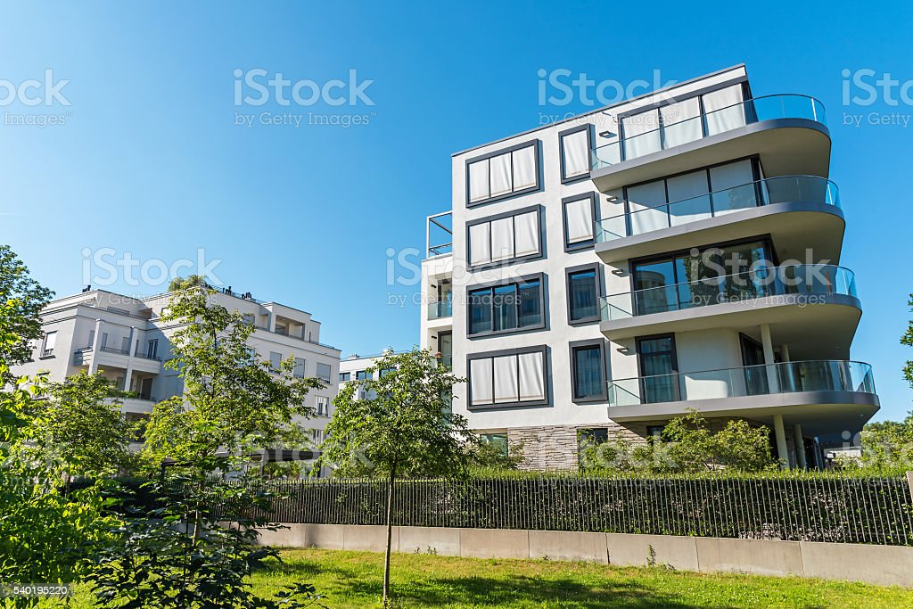Beautiful apartment houses with garden stock photo