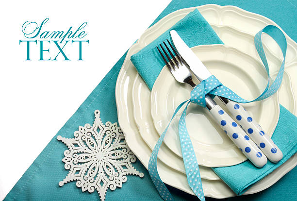 beautiful aqua blue festive christmas dining table place setting - blue table setting stock photos and pictures