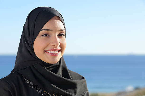 beautiful arab saudi woman face posing on the beach - arabic girl stock photos and pictures