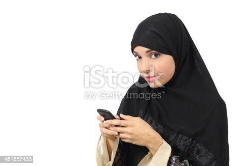 istock Beautiful arab woman browsing her smart phone 451557433