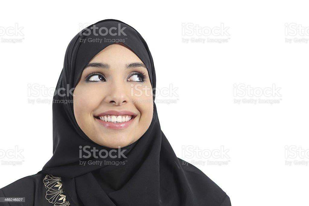 Beautiful arab woman face looking an advertising above stock photo