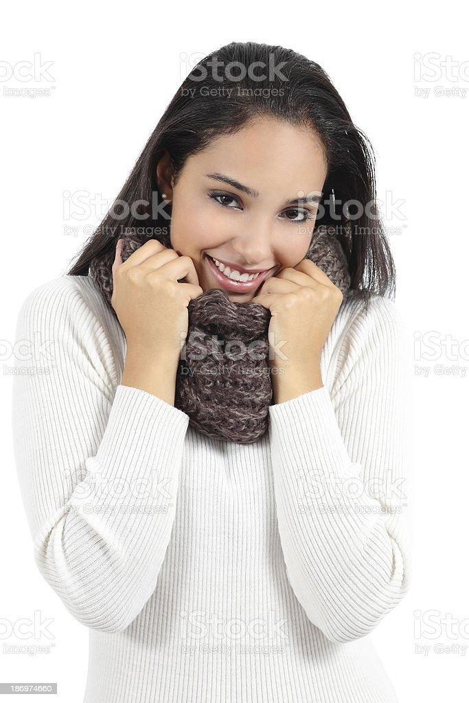 Beautiful arab woman warmly clothed grabbing a scarf stock photo