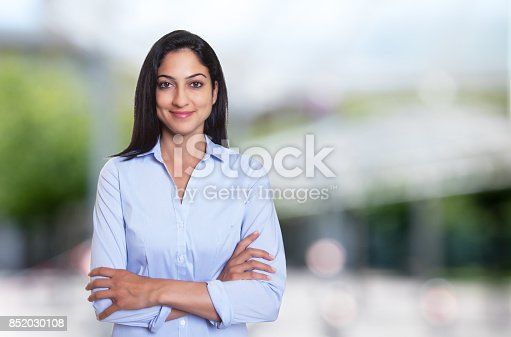 istock Beautiful arabic businesswoman with crossed arms 852030108