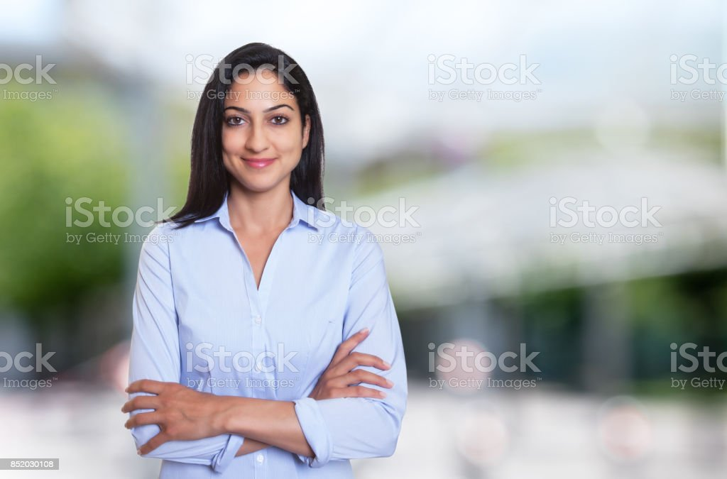 Beautiful arabic businesswoman with crossed arms stock photo