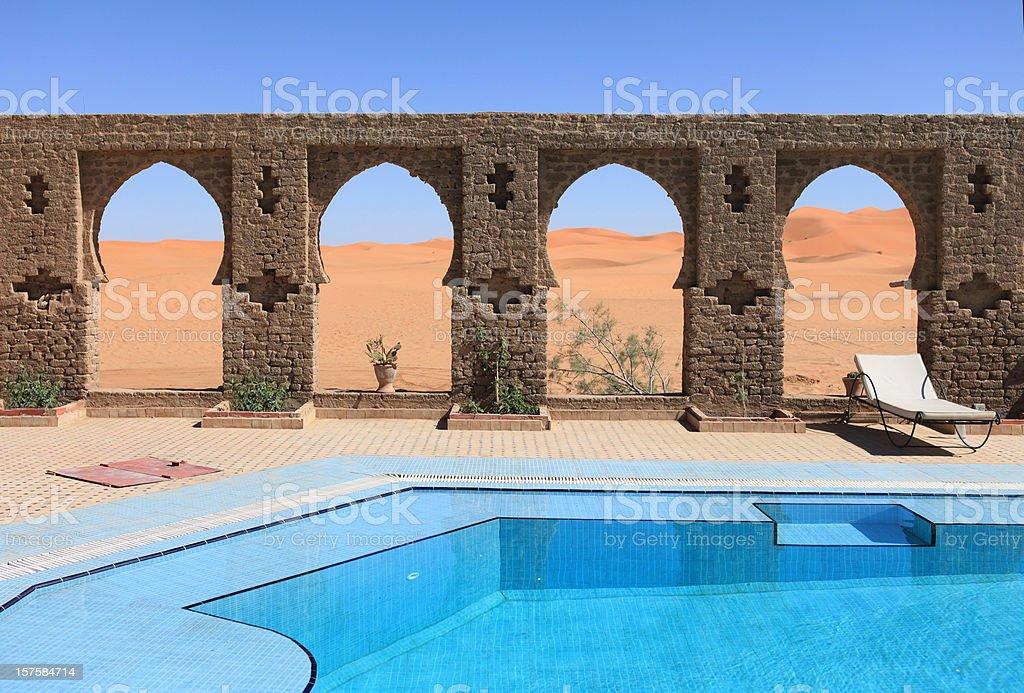Beautiful arches by swimming pool in Sahara desert, Erg Chebbi Dunes,...
