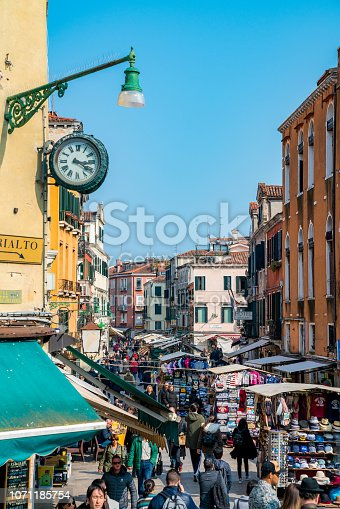 Venice, Italy - April 12, 2018: Beautiful architecture in Venice with amazing rusty buildings, balconies and traditional design.