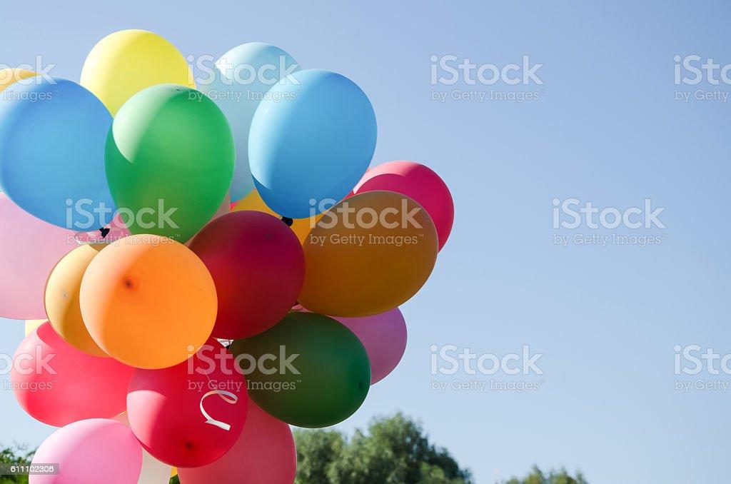 beautiful armful of balloons stock photo