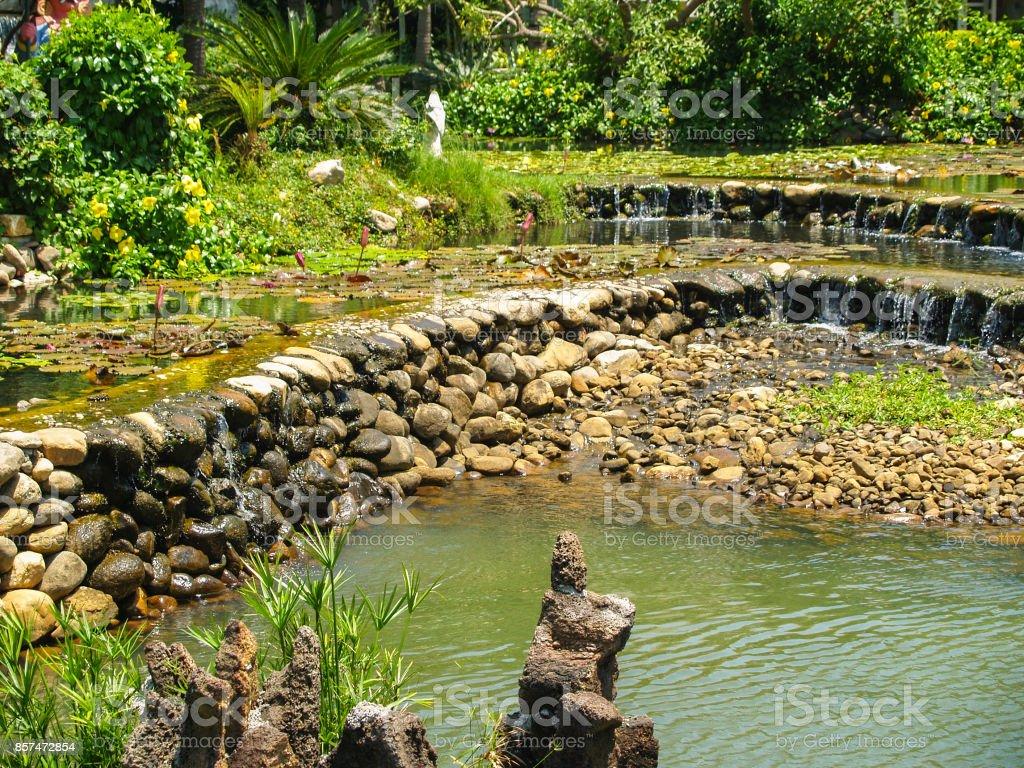 Beautiful artificial cascade lake stock photo