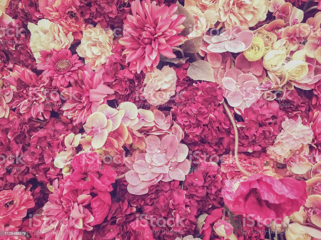 beautiful artificial flowers wall background with pink style,...