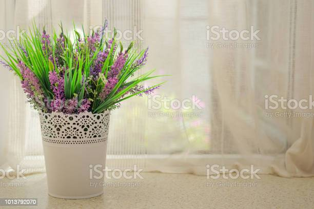 Beautiful artificial flowers with lavender on the window picture id1013792070?b=1&k=6&m=1013792070&s=612x612&h=au2hliong68mthlt4o58df24xlgkrpv ezvtnwrc76k=