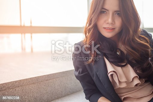 istock Beautiful Asia business woman over blue office background. 857652238
