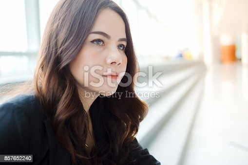 istock Beautiful Asia business woman over blue office background. 857652240
