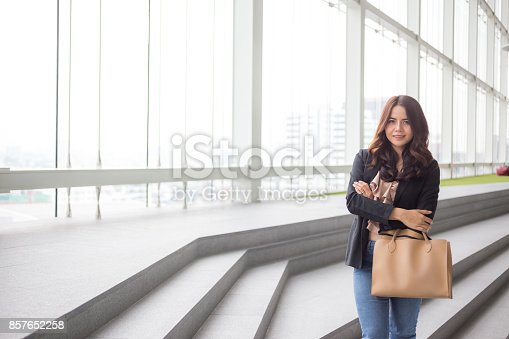 istock Beautiful Asia business woman over blue office background. 857652258