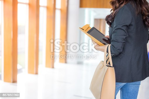 istock Beautiful Asia business woman over blue office background. 857652260
