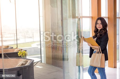 istock Beautiful Asia business woman over blue office background. 857652262