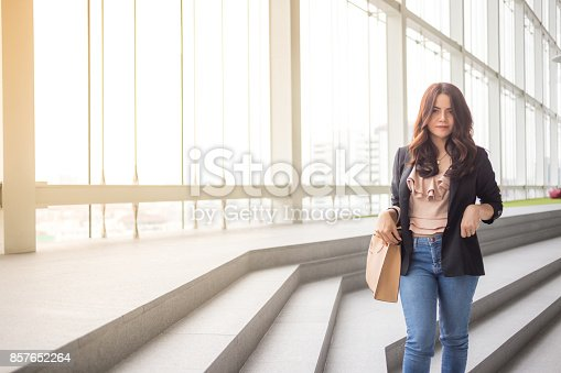 istock Beautiful Asia business woman over blue office background. 857652264
